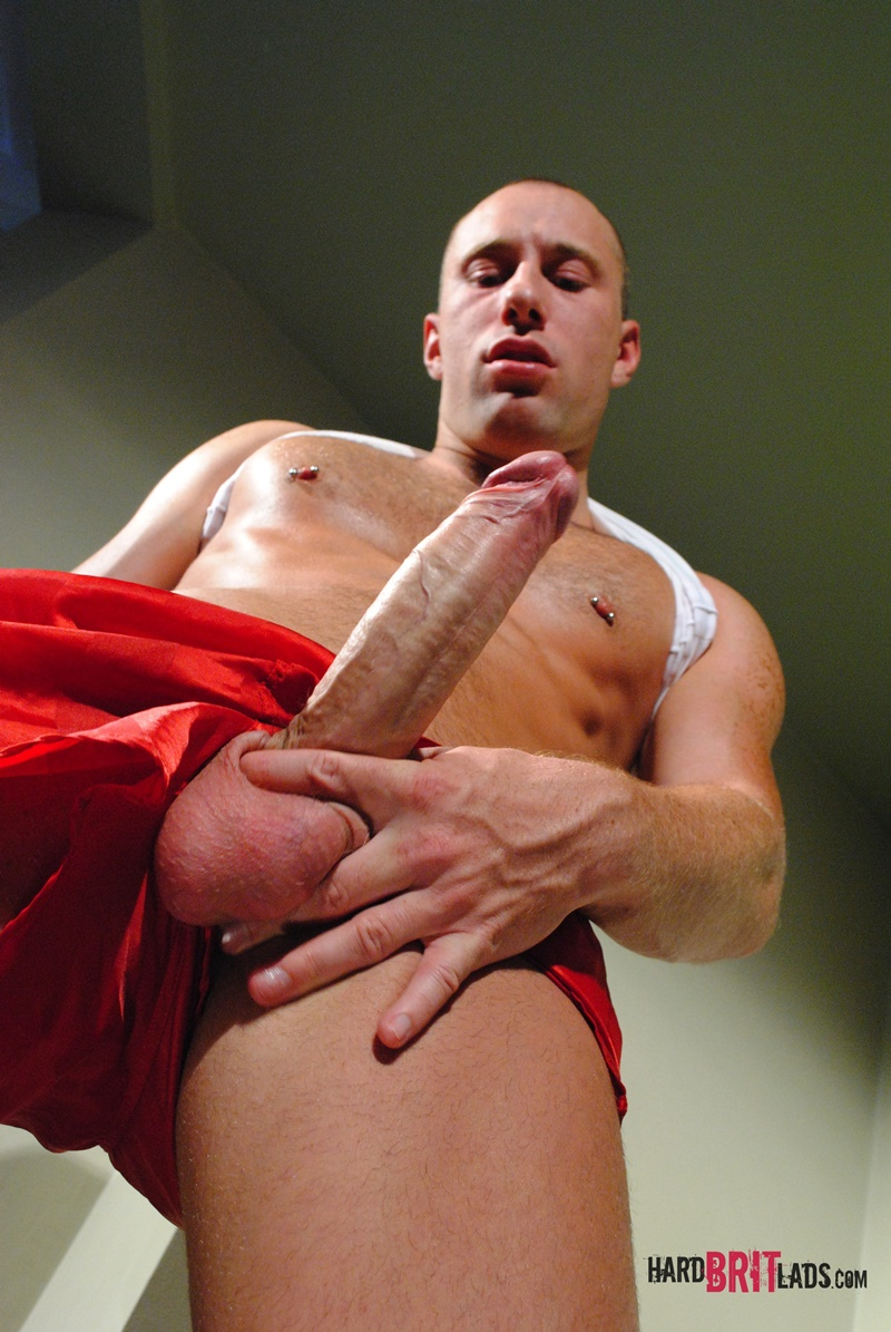 HardBritLads-Tall-sexy-skinhead-Edward-Fox-ripped-six-pack-abs-huge-uncut-9-inch-cock-red-sports-shorts-foreskin-jerking-shaved-head-006-gay-porn-sex-gallery-pics-video-photo